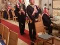 Der Ceremonienmeister Rt Marc Ampere bringt den zu Ehrenden